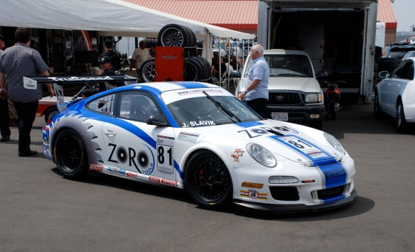 White & blue striped Zoro Tools Porsche GT3 cup car #81_garage 2_3/4 front view_California Festival of Speed_April 6, 2013