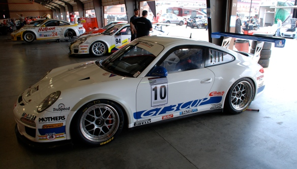 White & blue striped TruSpeed Porsche GT3 cup car #10_garage 2_California Festival of Speed_April 6, 2013