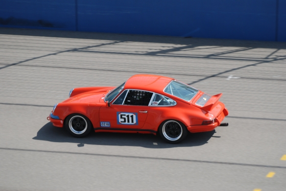 Tangerine colored Porsche 911 race car #511 at speed_California Festival of Speed_April 6, 2013