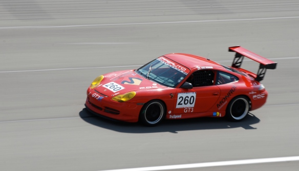 Red Porsche 996 Monroe Consulting Koni cup car#260_pan shot _California Festival of Speed_April 6, 2013