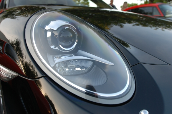 Black 2013 Porsche 991 Carrera S_headlight, fender and hood reflections_Cars&Coffee/irvine_April 27, 2013