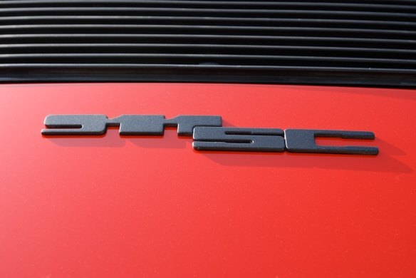 Sumner's 1983 India red Porsche 911SC_ rear decklid badge detail_Cars&Coffee/Irvine_April 27, 2013