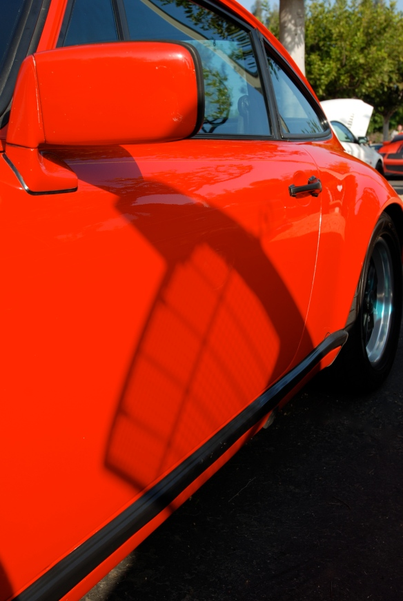 Sumner's 1983 red Porsche 911SC_ Mercedes-Benz grill shadowing on door_Cars&Coffee/Irvine_April 27, 2013