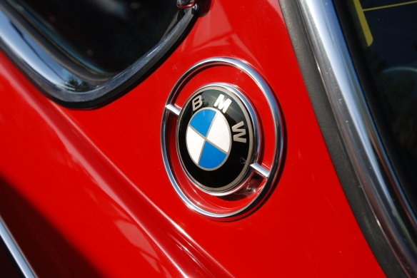 Red 1973 BMW 3.0 CS coupe_BMW rondel detail _Cars&Coffee/Irvine_April 27, 2013
