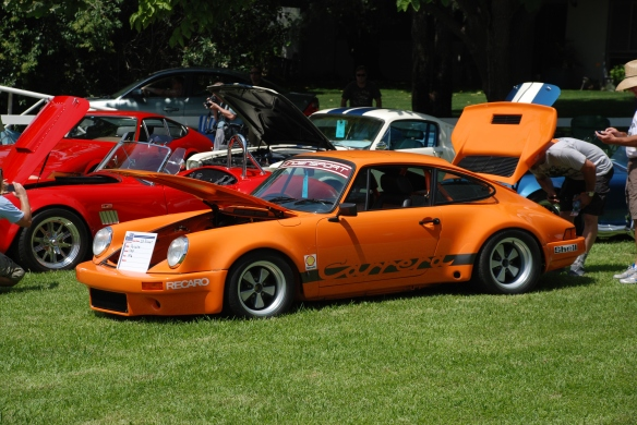 Orange 1976 Porsche 911 turbo _3/4 long side view, group shot _Boys Republic / Steve McQueen car&motorcycle show _June 1, 2013