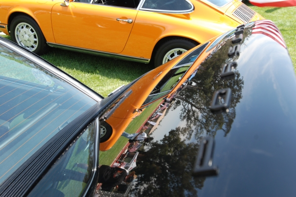 Black 1973 Porsche 911E coupe_rear decklid reflections / Signal Yellow 911, Porsche row_Boys Republic / Steve McQueen car&motorcycle show _June 1, 2013