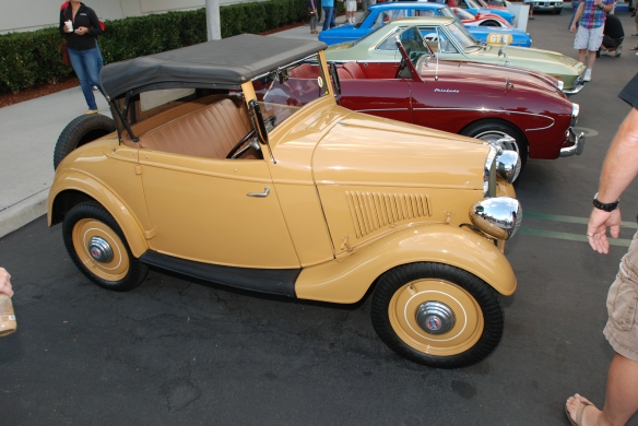 1935 Datsun 14 roadster (#002)yellow_3/4 side view _Cars&Coffee_August 31, 2013