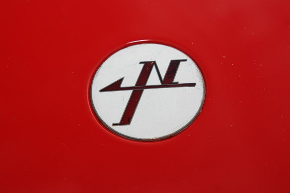 Red & white 1967 Nissan R380-ii sports prototype_front nose emblem_ Cars&Coffee_August 31, 2013