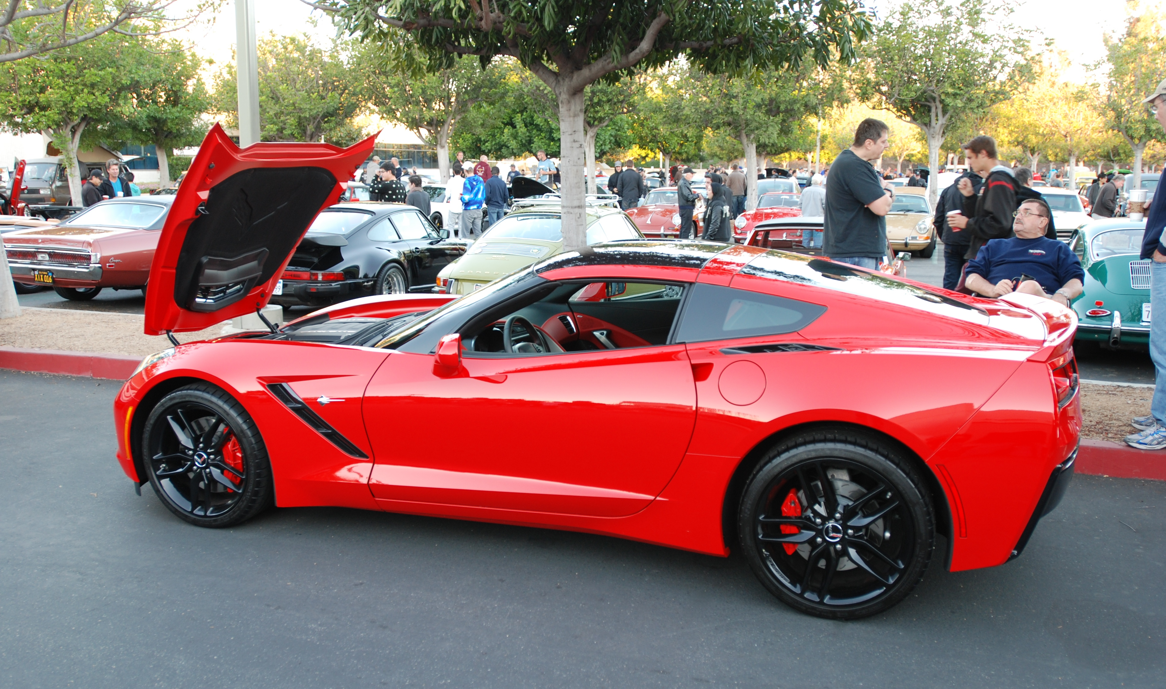 2014 torch red corvette sting ray_ 3 4 side view_cars coffee irvine_november 2