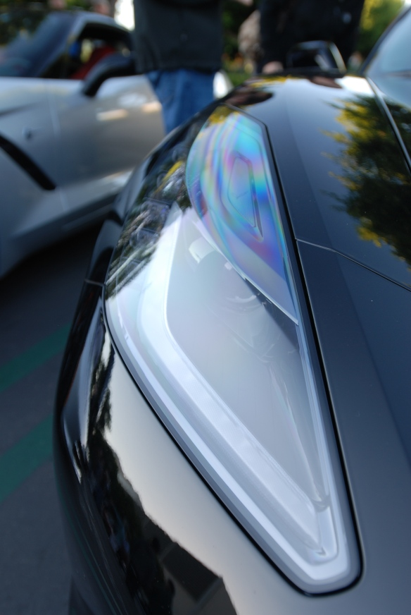 2014 Black on black Corvette Sting Ray_ polarized light refractions visible on the headlight lens_cars&coffee/irvine_November 2, 2013