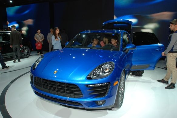 Blue 2014 Porsche Macan_front view with open doors and reflections_LA Auto Show_ November 23, 2013