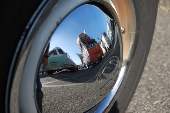 Hubcap reflection_green & white bus and sealing wax red bus_OCTO Winter meet_Long Beach , CA_February 8, 2014