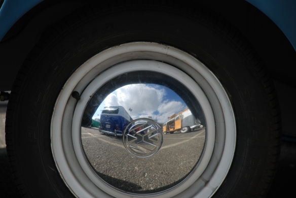 Hubcap reflection_straight on view , blue & white bus reflected_OCTO Winter meet_Long Beach , CA_February 8, 2014