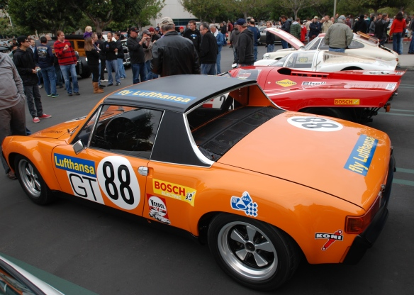 1970 Signal Orange Lufthansa Porsche 914-6 GT with Porsche race cars_ 3/4 rear group shot_cars&coffee/irvine_january 25, 2014