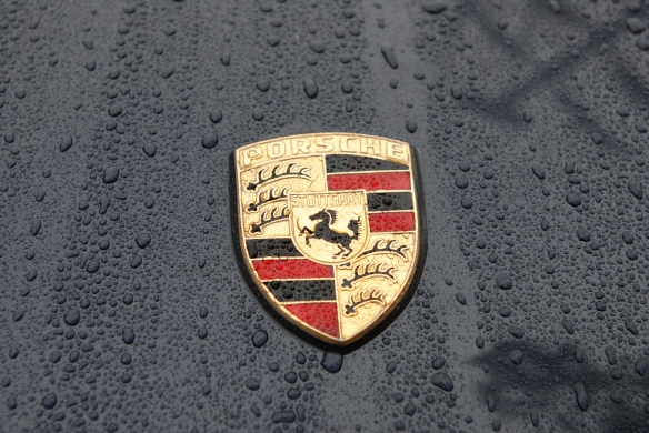 Front hood emblem on dark blue Porsche 911 Carrera_rain drops & emblem_Phoenix Club Car show & Swap_March 3, 2014