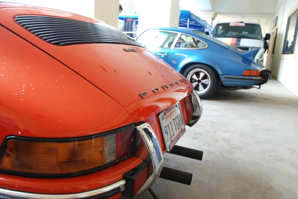 Early Porsche 911s_ orange 1970s 911T, 1973  Blue 911S_3/4 rear view_Phoenix Club Car show & Swap_March 3, 2014