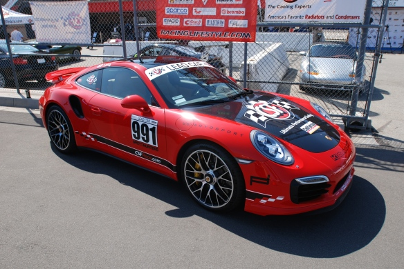 2014 Guards Red Porsche 991 Turbo S_3/4 front view pit row_California Festival of Speed_4/5/14