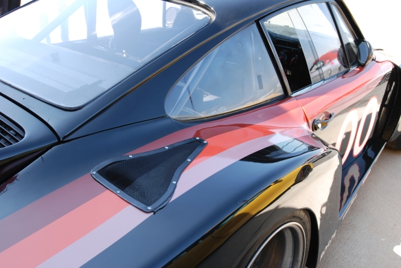 TruSpeeds restored,1978 Interscope racing Porsche 935 twin turbo_3/4 rear view with top of fender reflections _California Festival of Speed_4/5/14
