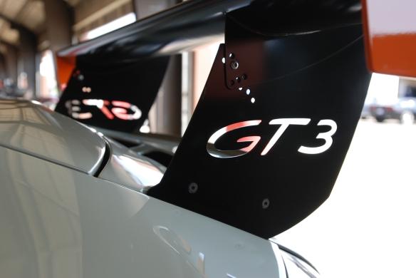 Stone gray type 996 GT3 Cup car_ rear wing strut /  in garage _California Festival of Speed_4/5/14
