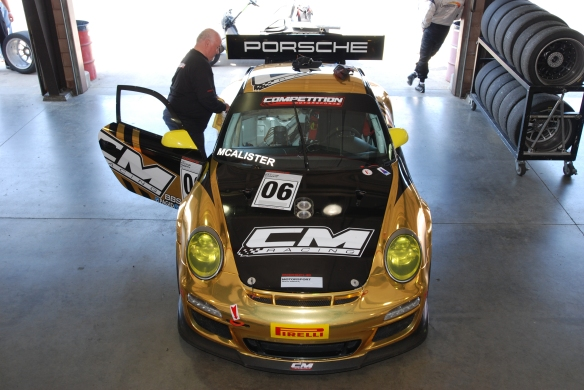 Black and gold mylar wrap # 06, Porsche 997 GT3 Cup car_ front view in garage _California Festival of Speed_4/5/14