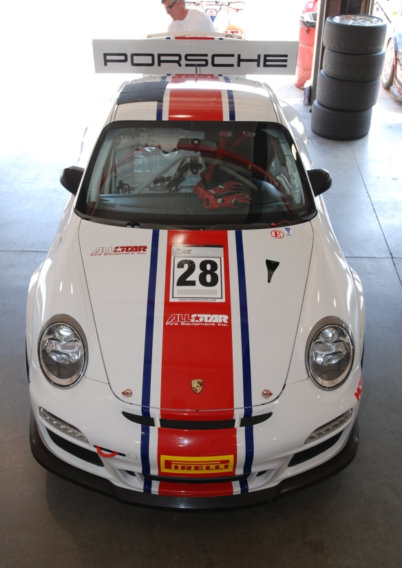 white w/red and blue stripe, all star # 28  Porsche  type 997 GT3 Cup car_ front view in garage _California Festival of Speed_4/5/14