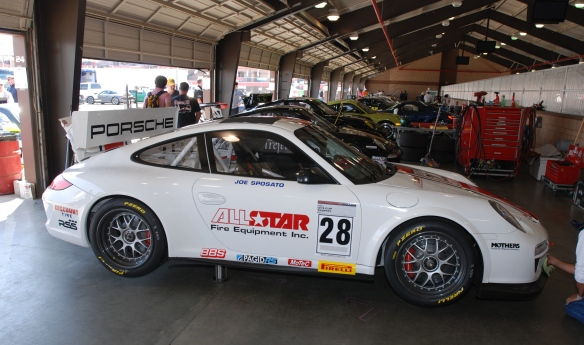 white w/red and blue stripe, All Star # 28  Porsche  type 997 GT3 Cup car_ side view in garage _California Festival of Speed_4/5/14