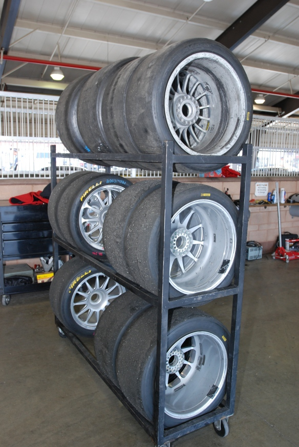 Porsche GT 3 Cup car wheels and Pirelli race rubber_tire rack in garage _California Festival of Speed_4/5/14