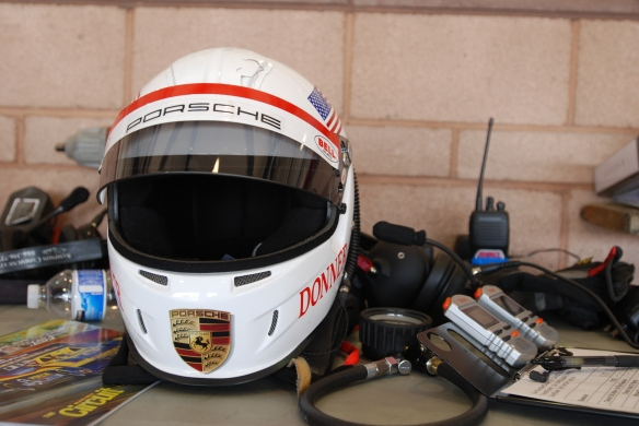 Drivers helmet, clipboard and stop watches on bench_ in garage _California Festival of Speed_4/5/14