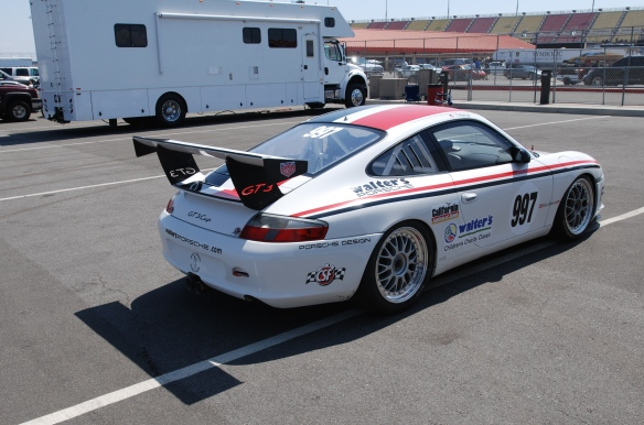 White #997, Type 996 Porsche GT3 Cup car, with red & black stripes_3/4 rear view /in trailer area _California Festival of Speed_4/5/14