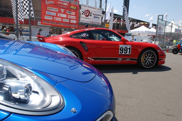 2014 Sapphire Blue metallic Porsche 991 Turbo S _nose view on pit row_California Festival of Speed_4/5/14