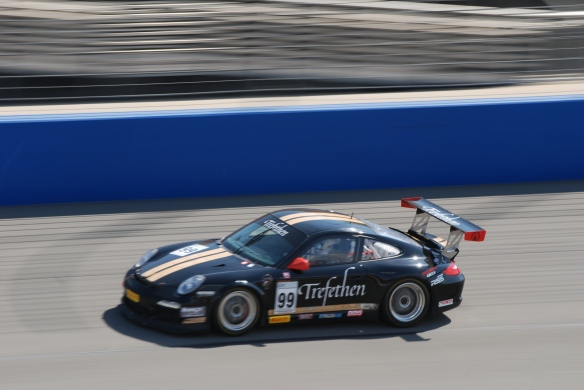Pirelli GT3 Cup races_ GT3 cup cars on track / black #99 Trefethen Porsche pan shot_California Festival of Speed_4/5/14