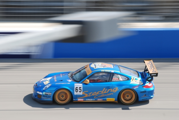 Pirelli GT3 Cup races_ GT3 cup cars / blue & gold #65  Porsche, pan shot_California Festival of Speed_4/5/14
