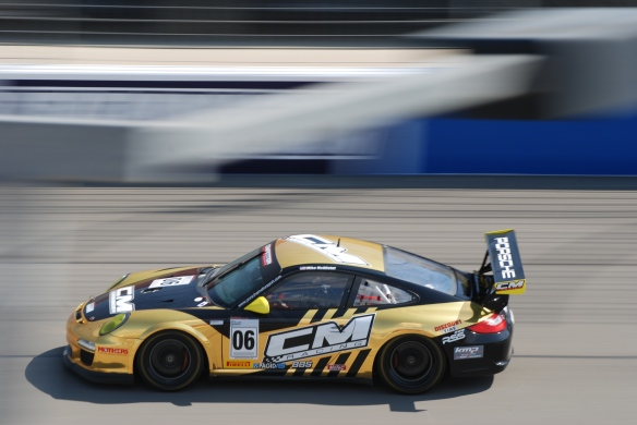 Pirelli GT3 Cup races_ GT3 cup cars /black & gold vinyl wrap , #06 CM racing  Porsche, pan shot_California Festival of Speed_4/5/14