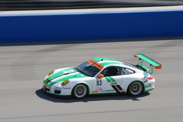 Pirelli GT3 Cup races_ GT3 cup cars / white & green , #53  J&M Porsche, pan shot_California Festival of Speed_4/5/14