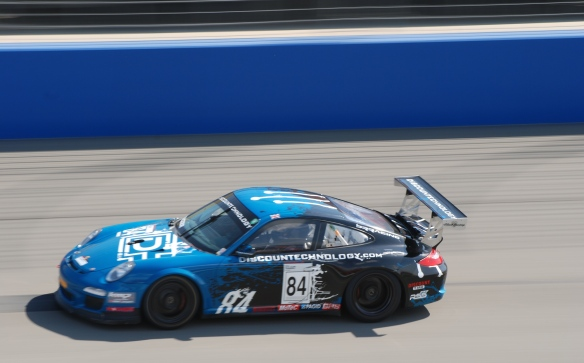 Pirelli GT3 Cup races_ GT3 cup cars / black & blue , #84  Discountechnology.com Porsche, pan shot_California Festival of Speed_4/5/14