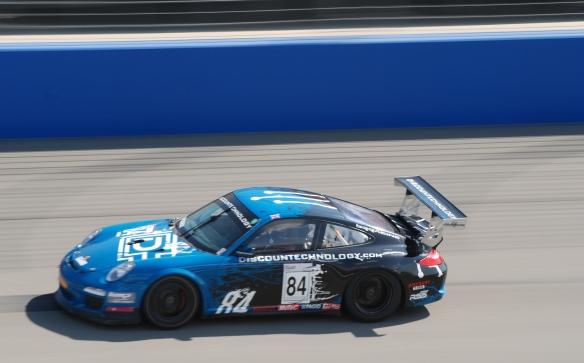 Pirelli GT3 Cup races_ GT3 cup cars / black & blue , #84  Discountechnology.com Porsche, pan shot_California Festival of Speed_4/5/14