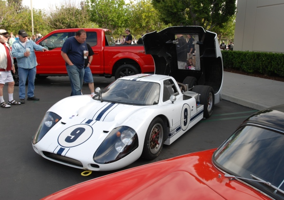 White 1967 Ford GT MK IV_3/4front view with red speedster in foreground_cars&coffee/irvine_May 10, 2014