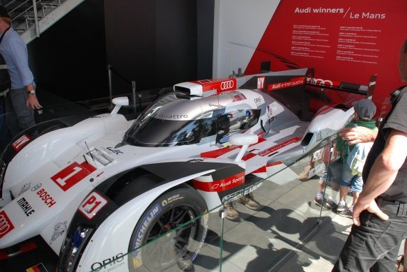 Audi Boutique at La Chapelle_2014 Audi R-18 e-tron on display_3/4 side view_Le Mans24_June 14, 2014