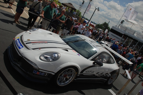 Porsche boutique_fan stop_GT3 Cup Car_3/4 side view__village infield_Le Mans24_June 14, 2014
