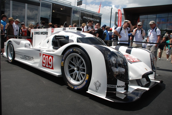 Porsche boutique_fan stop_LMP1, 919 Hybrid_3/4 front view__village infield_Le Mans24_June 14, 2014