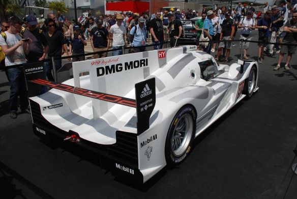 Porsche boutique_fan stop_LMP1, 919 Hybrid_3/4 rear view__village infield_Le Mans24_June 14, 2014