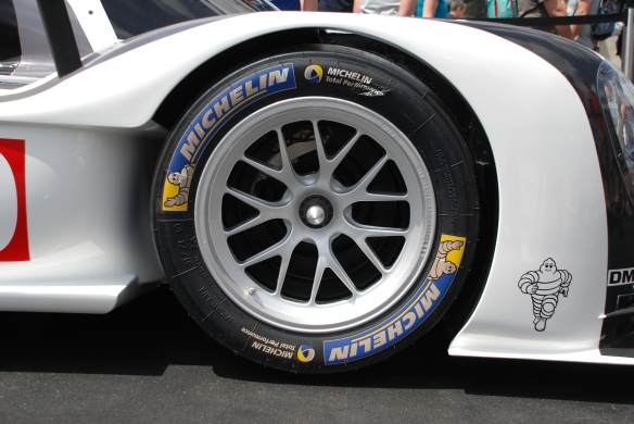 Porsche boutique_fan stop_LMP1, 919 Hybrid_front wheel & tire detail__village infield_Le Mans24_June 14, 2014