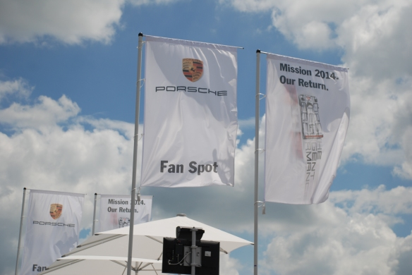 Porsche boutique_fan stop_roof top banners__village infield_Le Mans24_June 14, 2014