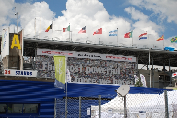 Porsche supergraphics_the most powerful..._pit row grandstands_Le Mans24_June 14, 2014