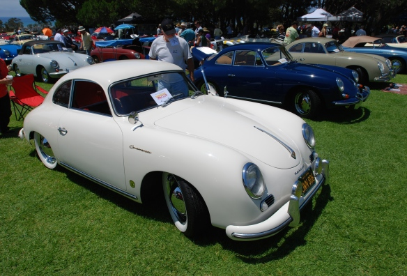 White 1955 continental coupe_3/4 front view_2014 Dana Point concours_July 20, 2014