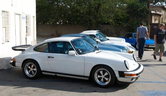 Porsche evolution row_1986 911 Carrera, Blue 911SC, white 993 Turbo, white 964 coupe_3/4 side view_ Luftgekuhlt event_Sunday September 7, 2014
