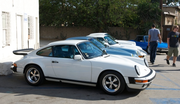 Porsche evolution row_1986 911 Carrera, Blue 911SC, white 993 Turbo, white 964 coupe_3/4 side view_ Luftgekuhlt event_Sunday September 7, 2014