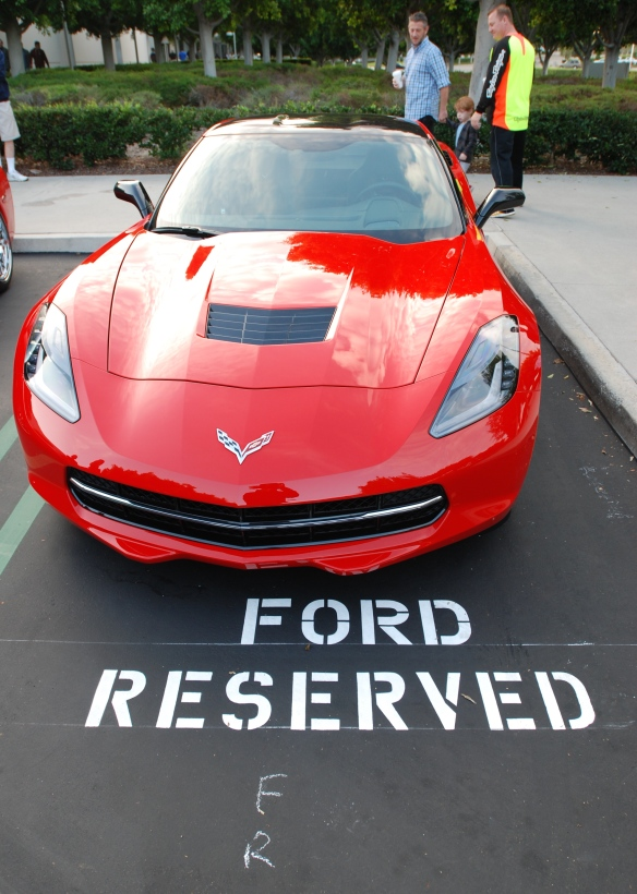 Red Corvette C7_front view w/reflections & Ford reserved painted parking space graphic_cars&coffee_October 18, 2014