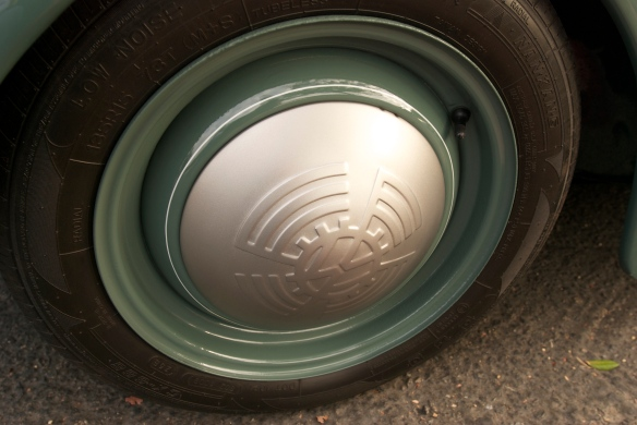 Green late 1950s VW Oval window beetle_hub cap detail_cars&coffee_October 18, 2014